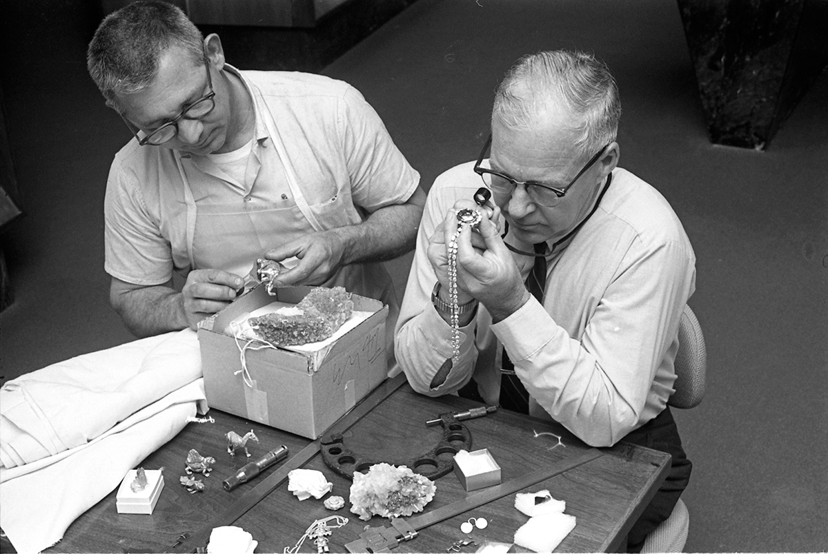 Smithsonian Institution Archives. Dr. George Switzer, Chairman of the Department of Mineral Sciences at Museum of Natural History, with Hope Diamond.