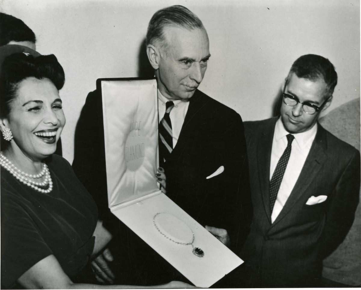 Historic Images of the Smithsonian Institution. Mrs. Edna Winston presenting the Hope Diamond to Secretary Leonard Carmichael and George Switzer, 1958.